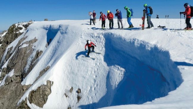 Gavin Carruthers dropping in to Tower Gully on Ben Nevis Photo by Blair Aitken.jpg